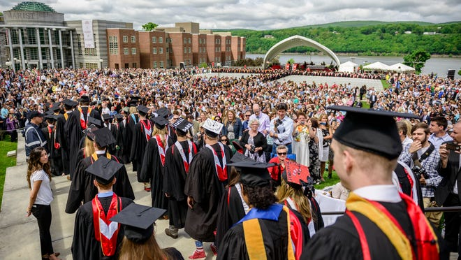 Marist College graduates walk in the processional as thousands of family members and friends watch on during the 68th annual commencement ceremony in Poughkeepsie on Saturday, May 24, 2014.