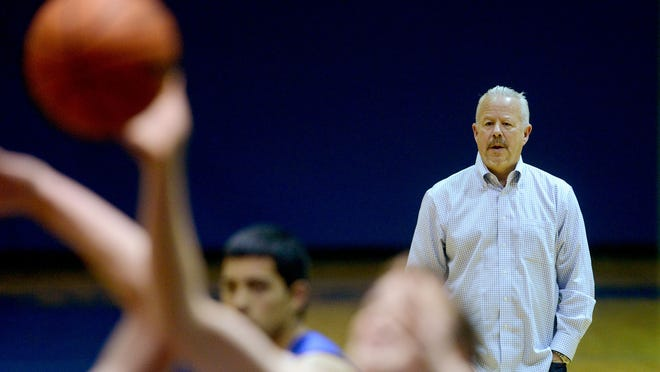 Scott Cantonwine, the new head coach, for the Blanchet Catholic boy's basketball team, leads a practice on Thursday, Dec. 11, 2014. Cantonwine is returning to high school coaching after nearly 20 years.