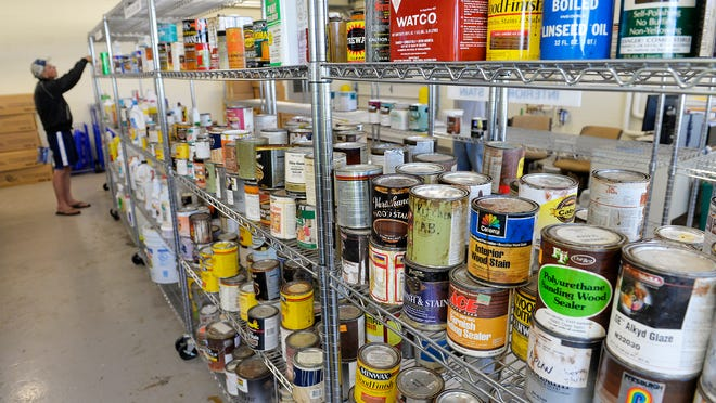 A customer peruses the shelves of the product exchange Thursday at the Stearns County Hazardous Waste Facility in Waite Park. Leftover but usable paint, stains, strippers, lawn and garden chemicals and pesticides, and other items are all available for free.
