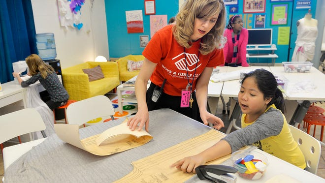 Amy Sinning, a fashion designer from Mankato, works with Courtney Keays, 11, a Lincoln Elementary School fifth-grader, Tuesday at the Eastside Boys & Girls Club. Sinning teaches a sewing and fashion class there.