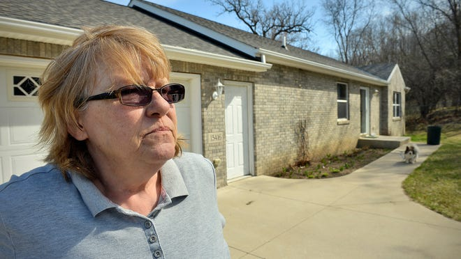 Peg Hesse talks April 15 outside her Cold Spring home. She is among a group of former employees trying to collect on about $22 million in promissory notes from the original Creative Memories bankruptcy.