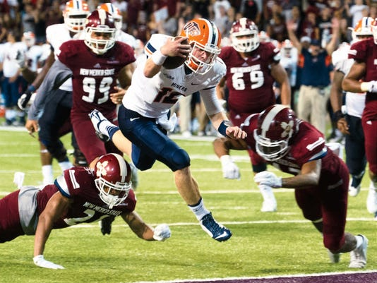 Gary Mook/For the Sun-News   UTEP quarterback Ryan Metz scores a late touchdown on Saturday against New Mexico State to force overtime. UTEP beat NMSU 50-47 at Aggie Memorial Stadium.