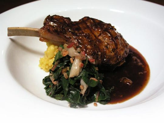 A grilled, stuffed veal chop at Chef Mike's ABG in