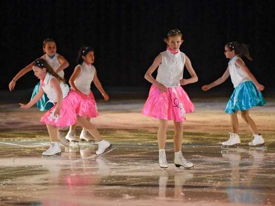 "Skaters perform ÒGreaseÓ Friday, March 24, during the St. Cloud Figure Skating Club's performance ""Blades on Broadway."""