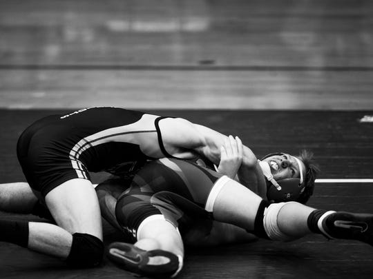 Palmetto's Mickey Samples (right) gets pinned by Powdersville's Liam McKinney at the Palmetto wrestling match Thursday against Powdersville .
