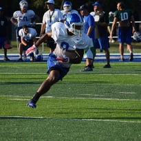UWF receiver Lawrence Lee, a West Florida High graduate, runs a pass drill Wednesday at Pen Air Field after getting cleared to play in Saturday's game against Florida Tech. It will be Lee's first game in nearly two seasons after his exit from Missouri