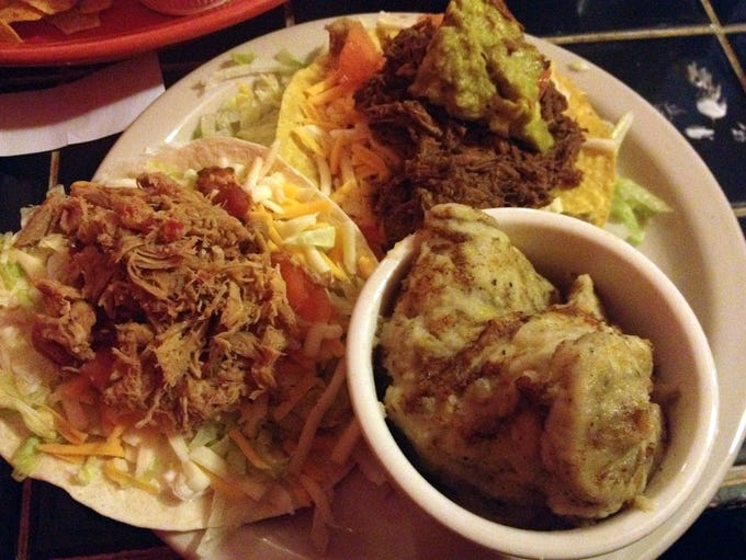 The dinner combo at John's Tex-Mex includes refried