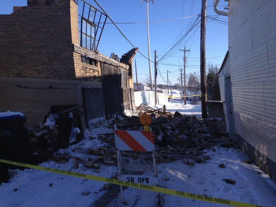 The second floor of a storage area attached to Bayside Bargains collapsed Sunday afternoon. Cinder blocks and other debris littered the roof of a neighboring business and the alleyway.