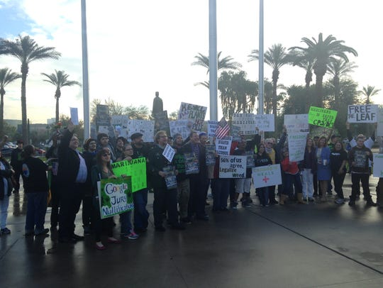 Protesters displayed signs calling for marijuana legalization
