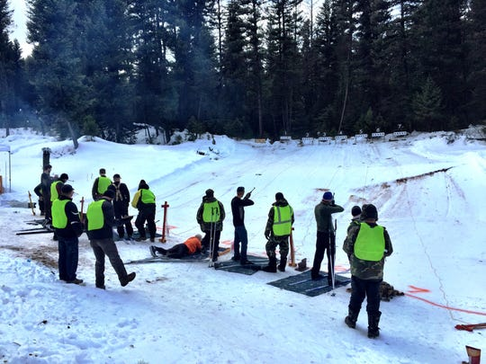 Competitors shoot during the Seeley Lake Challenge Biathlon. The sport combines cross-country skiing and shooting.