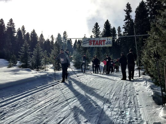 A skier leaves the starting line at the Seeley Lake Challenge biathlon.