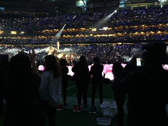 Members of the Corona del Sol marching band choreograph props during Katy Perry's Super Bowl halftime show.