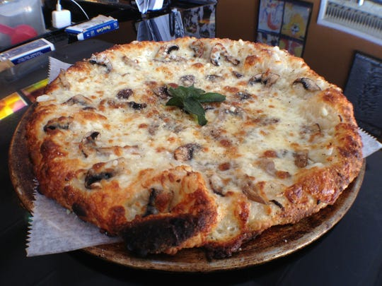 Nice Guys fashions its Truffle Shuffle pizza with portabella mushrooms, garlic, onions, provolone, Parmesan, mozzarella, fresh ground pepper and crisp sage, drizzled with black truffle oil.