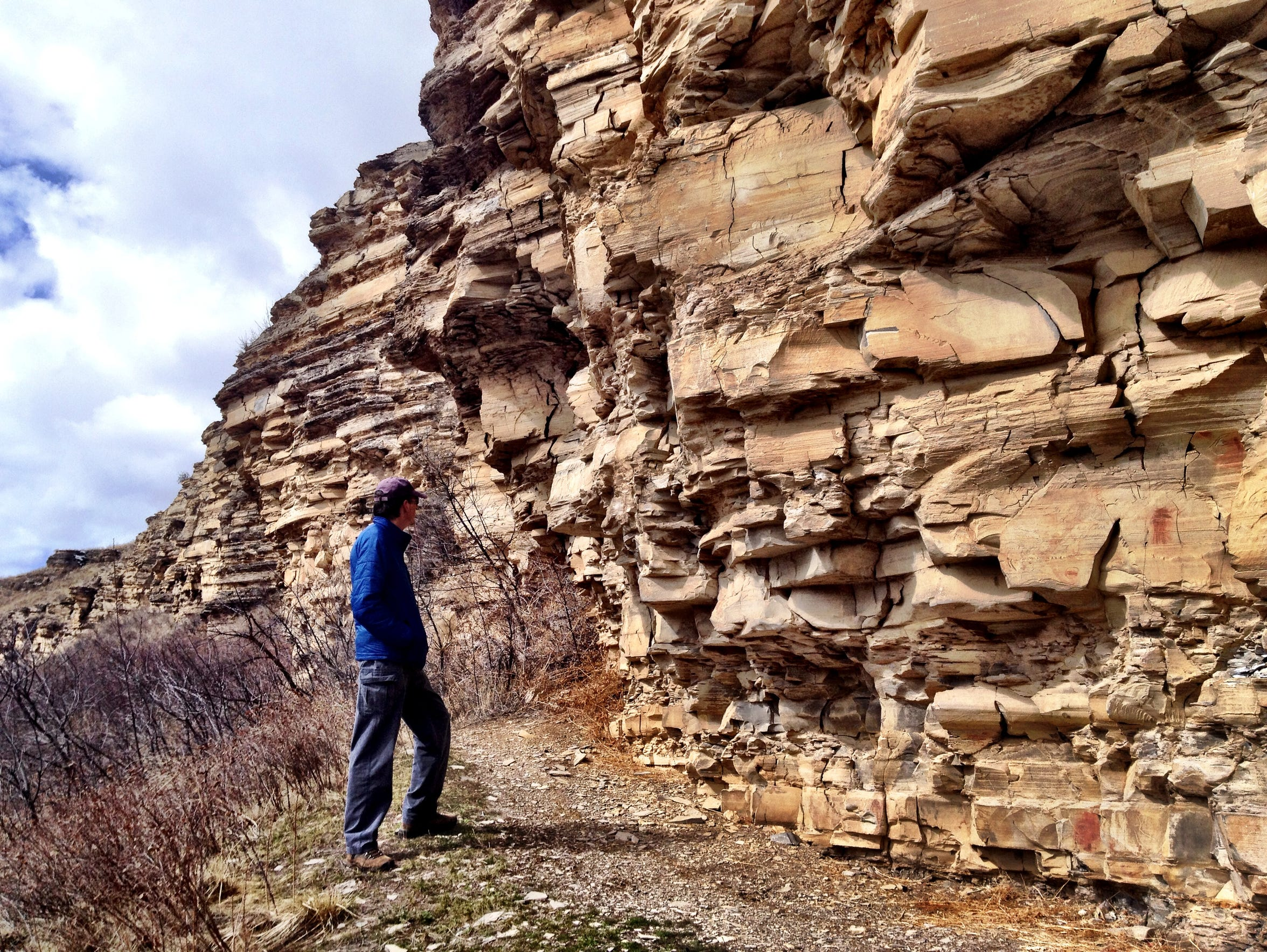 A visitor explores Bear Gulch Pictographs near Lewistown.
