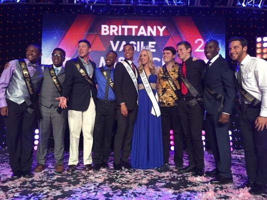 635589980483395866-Ms.-UCF-2015-Brittany-Vasile-with-the-2015-Mr.-UCF-contestants.