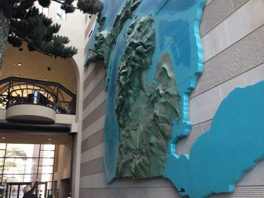A massive diorama of Michigan's topography greets visitors