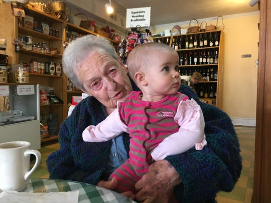 Pampered Palate Cafe regular Anna Pullin cuddles seven-month-old