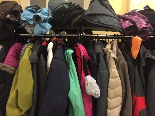 Piles of winter coats on a Stonewall Jackson Hotel