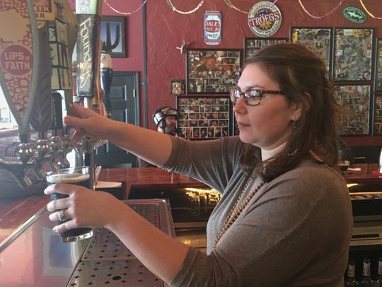Baja Bean barkeep Candace Christie pours an IPA for