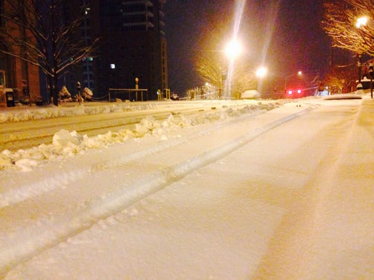 The snow-covered road in front of the Grove Arcade in downtown Asheville early Thursday.