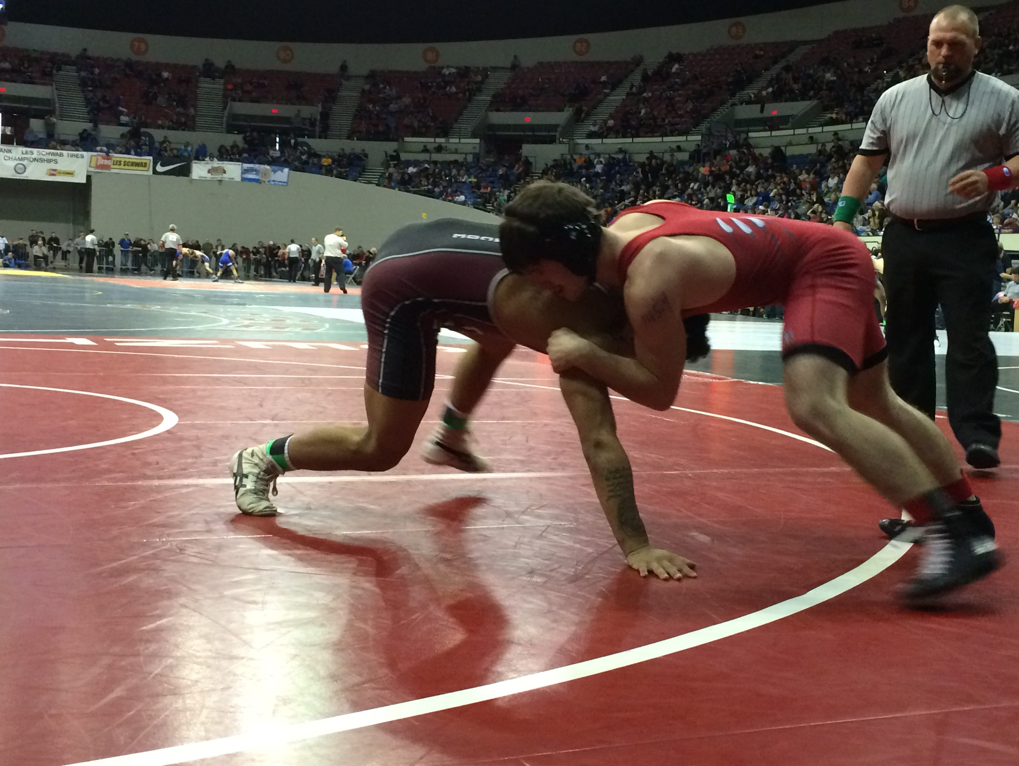 Glencoe's Anthony Lambert tries to stay up against McMinnville's Bobby Crowston.