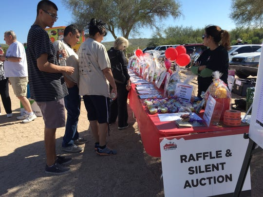 Multiple vendors and a silent auction greeted hikers at the trail head.