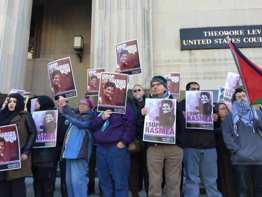 Supporters of Rasmieh Odeh, 67, protest in front of Federal Court in Detroit on Thursday, March 12, 2015, before she is sentenced for not disclosing her conviction in Israel in 1969 in a bombing that killed civilians.