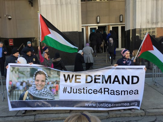 Supporters of Rasmieh Odeh, 67, protest in front of Federal Court in Detroit on Thursday, March 12, 2015, before she is scheduled to be sentenced for not disclosing her conviction in Israel in 1969 in a bombing that killed civilians.