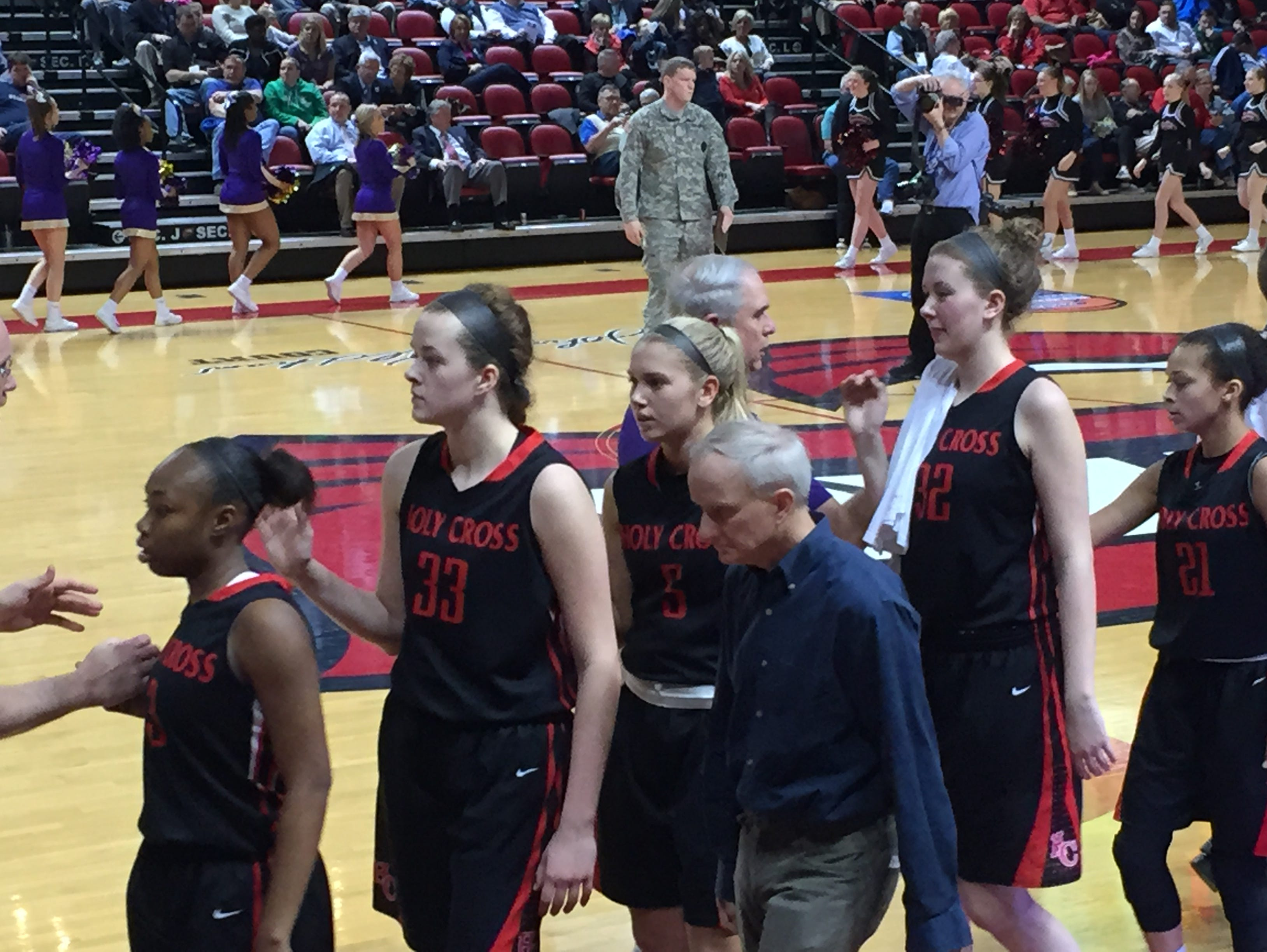 (From left) Dajah McClendon, Ally Mayhaus, Abby Hassert, Cessie Mayhaus and Aleah Tucker after Holy Cross defeated Male, 47-37, in the state semifinals on Saturday.