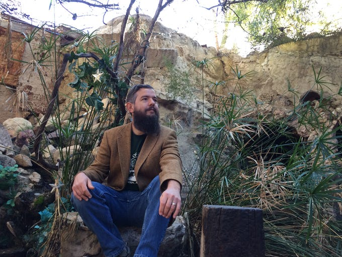 Zack Jarrett gives a tour of a miniature fairy castle,