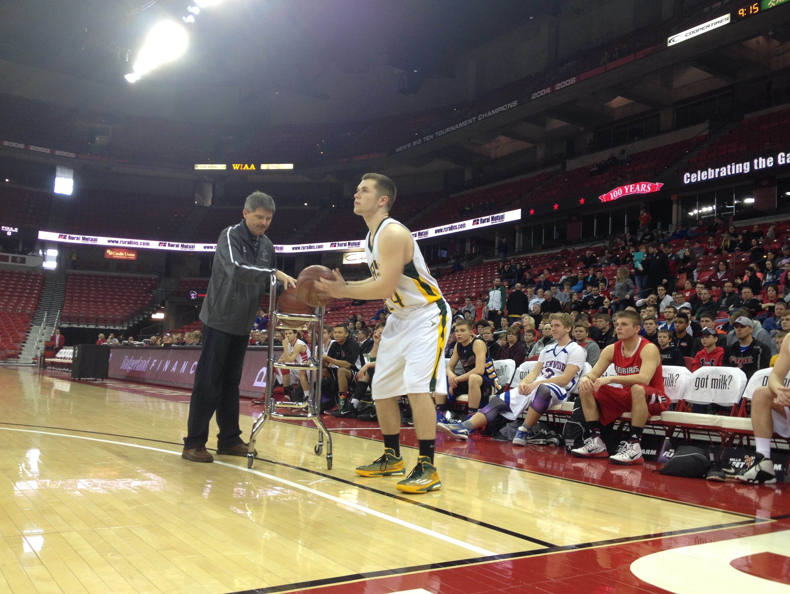 Freedom's Logan Maulick competes in a 3-point shooting contest Saturday as part of the WIAA boys' state basketball tournament at the Kohl Center in Madison.