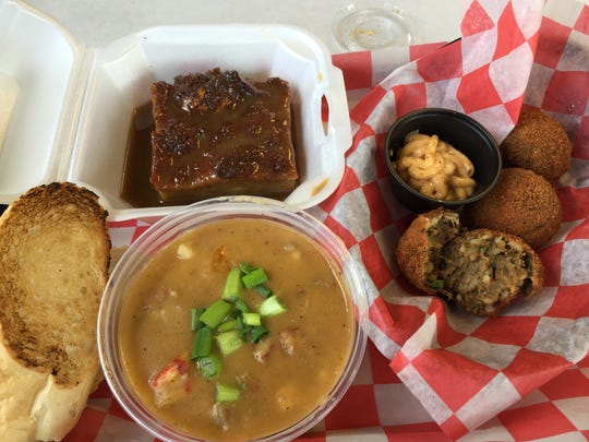 Boudin balls, crawfish etouffee and bread pudding with caramel sauce at new Chef Dan's in Irvington.