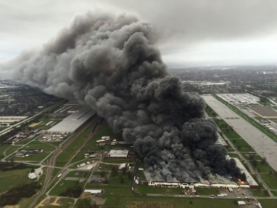 A massive smoke plume rises over GE's Appliance Park after a a four alarm fire broke out Friday morning at the plant.