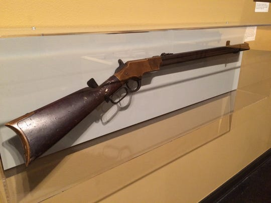 A 16-shot, lever action repeating Henry rifle made by New Haven Arms Company.