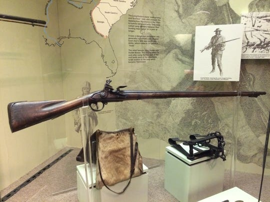 A flintlock musket thought to be carried by frontiersman Daniel Boone when he ventured into Tennessee and Kentucky in the 1770s.