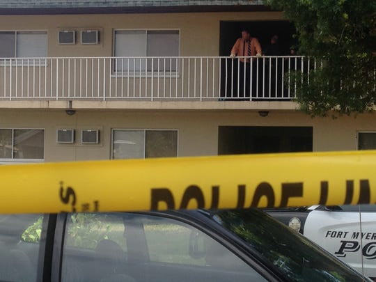 A Fort Myers Police Department detective surveys he crime scene where a man was found dead Sunday.