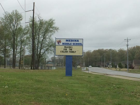 The sign outside Medina Middle School asks for prayers