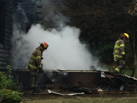 A home at 160 Union Church Road continued to smolder hours after a blaze that killed two people Wednesday.