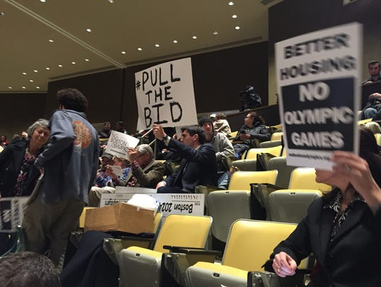 Opponents protest Boston's Olympic bid during a hearing
