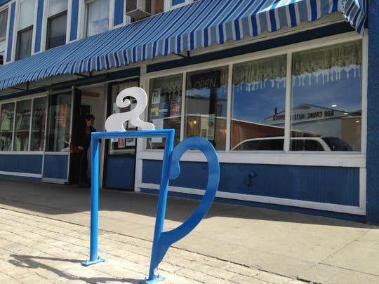 A bike rack shaped like a coffee cup sits outside Chris' Diner on State Street in Binghamton.