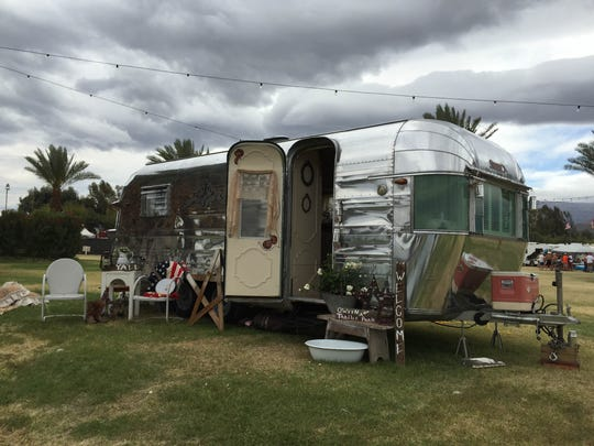 Vintage trailers from the 1940s and 1950s are displayed
