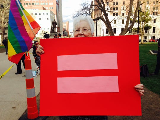 This is Shirley Hanna, of East Lansing, who attended the same sex marriage vigil because she believes in the issue and has a gay member in her family who she wants to support. Taken at a same sex marriage vigil at the state Capitol on Monday evening.
