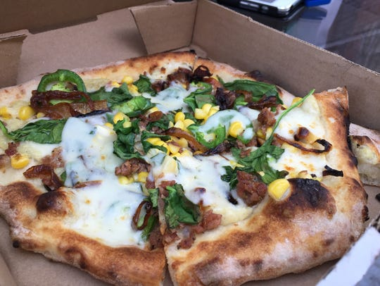Pi pizza truck's Indiana Corn Pi sports spinach, jalapenos,