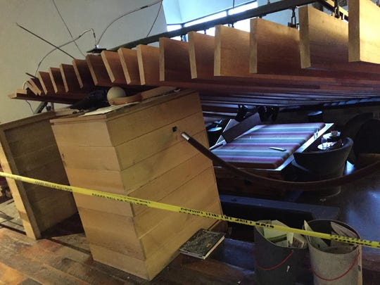 """The suspended ceiling that collapsed in the Hotel Vermont lobby Thursday evening, April 30, 2015, struck a hostess stand that kept it from crashing completely to the ground. """"The hostess stand saved the day,"""" General Manager Hans van Wees said. Five people were injured, four of whom were taken to the hospital for treatment."""