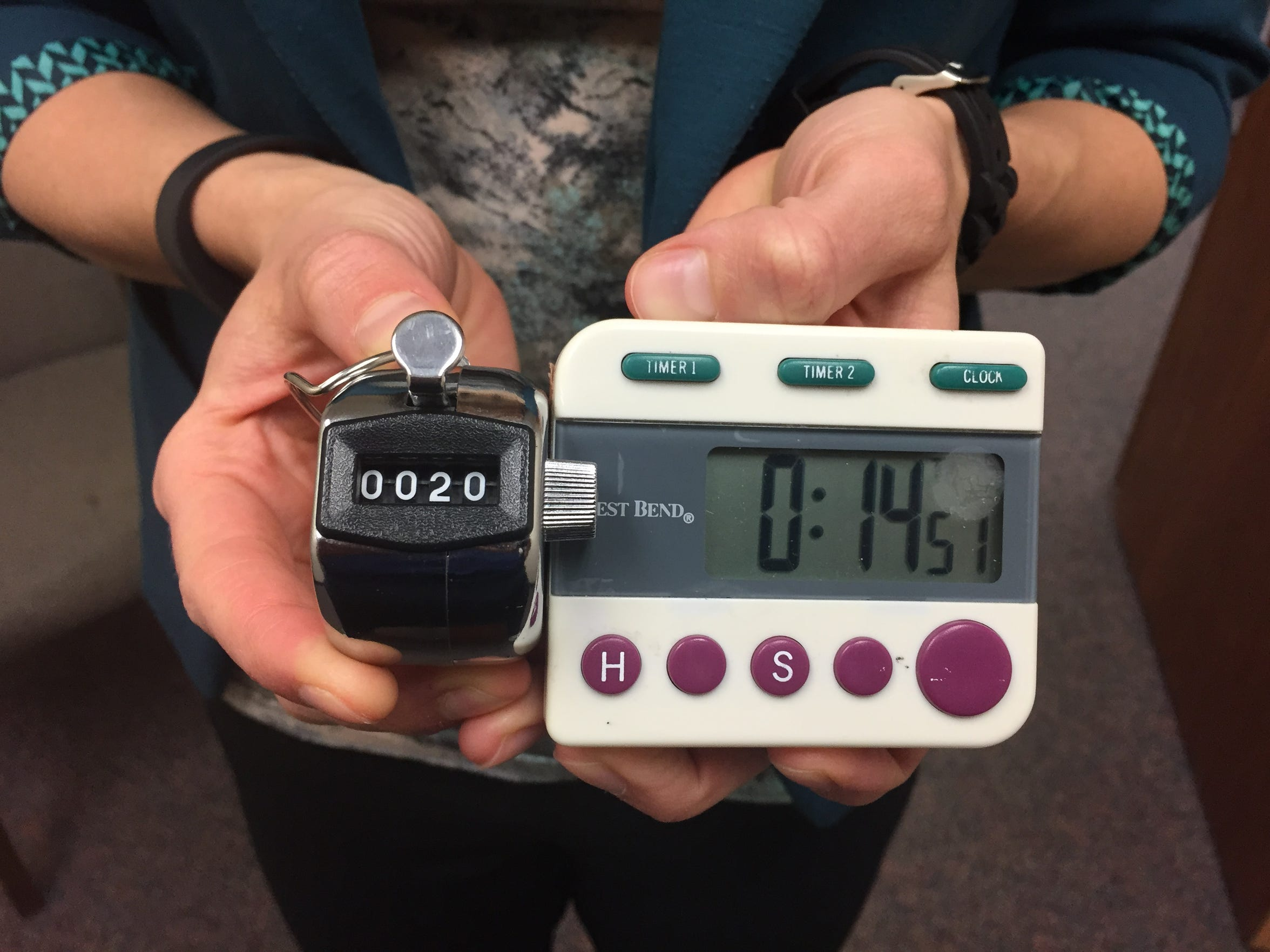 Physical therapist Stefanie Kirk holds the lap counter and timer for morbidly obese columnist Daniel Finney's latest walking test. He made 20 laps of 156 feet in less than 15 minutes, doubling his previous high of 10 laps just two weeks prior.