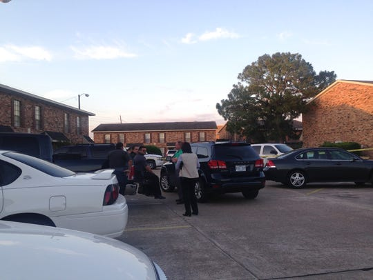 Authorities talk on the scene at Bell Downs Apartments,