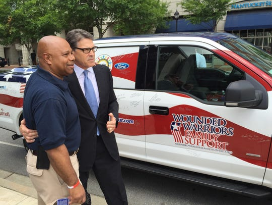 Rick Perry gets a photo taken with a potential voter