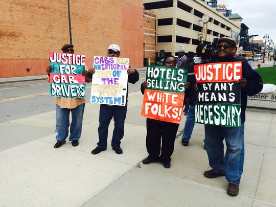 Detroit taxi cab drivers protest outside 36th District Court on Tuesday.