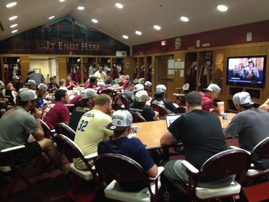 Florida State baseball players watch Monday's NCAA Tournament selection show.