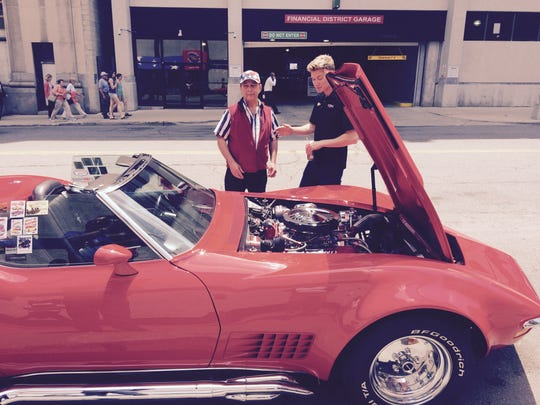 Dan Keros -- who used to run the family business, the American Coney Island -- shows off his 1970 Corvette to IndyCar driver Josef Newgarden.